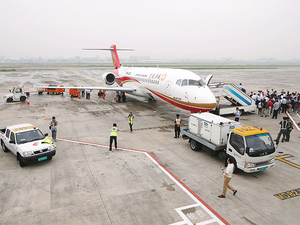 China's 1st home-made jet makes debut commercial flight - The