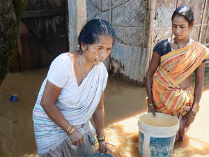 A women tries to find her way in Assam where more than 4,100 hectares of crop have been damaged.