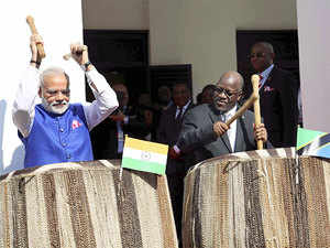 Both the leaders played the wooden drums after the Prime Minister was accorded a ceremonial welcome at the State House here.