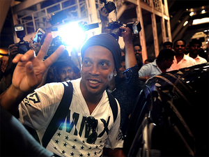 Sporting a casual t-shirt, shorts and studs, the former Barcelona and AC Milan star was swamped by the waiting media as he stepped out of the international airport late last night.