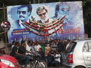 Fans of Super star Rajinikant decorating with flowers to the huge cut out for the up coming new film Kabali, in Bengaluru.