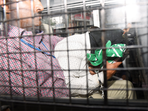 An ISIS accused being brought to the NIA special court at the Nampally criminal courts in Hyderabad.