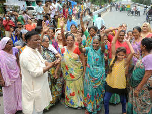 Members of Dalit community block traffic and shout slogans atGirdharnagar area of Ahmadabad on Wednesday,They protesting after four men belonging to the Dalit community were beaten while trying to skin a dead cow.