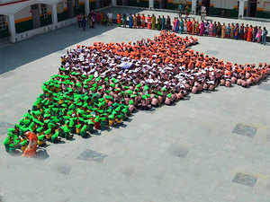 Students sits in formation to create India's map ahead of 70th Independence day celebrations in Jammu on Friday.