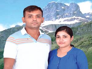 Theerta Prasad, with his wife, Priyanka