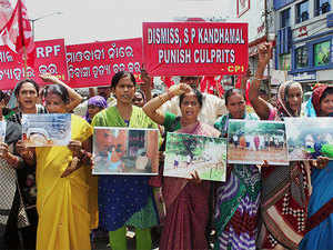 CPI activists hold a protest rally against the killing of five innocent tribals in police firing during an anti-Maoist operation in Kandhamal, in Bhubaneswar.