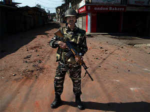 An Indian paramilitary soldier stands guard during curfew in Srinagar on August 17, 2016.