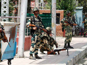 Border Security Force personnel deployed to enforce curfew at Regal chowk in Srinagar.
