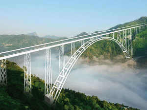 In about two years from now, the two sides of the River Chenab will be joined by a humungous steel bridge, being constructed with 24,370 tonnes of steel at a height of 359 m above the riverbed.