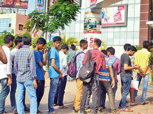 Customers line up to purchase Reliance Jio connections at a shopping mall in Visakhapatnam on September 2.