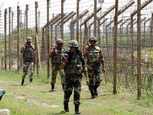 Indian Border Security Force (BSF) soldiers s perform a patrol near a border fence at the Suchategarh India-Pakistan international border.(File Photo)