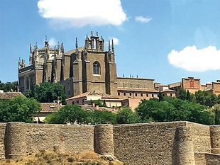 The palace-fortress of the Alcazar crowns Toledo's highest point, its Roman arch anointed with an imperial coat of arms depicting Visigothic kings.