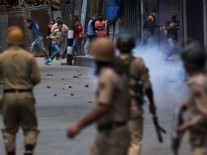 ​There are already 25,000 SPOs in the state, engaged on a monthly honorarium of Rs 6,000.   In this Aug. 31, 2016, file photo, protesters face policemen in Srinagar.