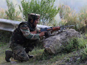 An Indian army soldier takes up a position near the Line of Control (LoC), in Uri.