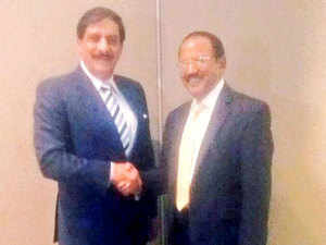 Ajit Doval NSA of India shaking hands with the NSA of Pakistan