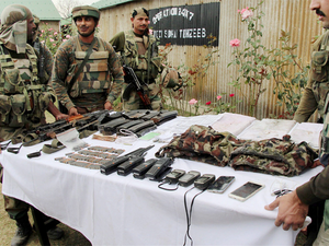 Drugs, clothes and weapons are among 67 exhibits sent by National Investigation Agency to prove Pakistani link.