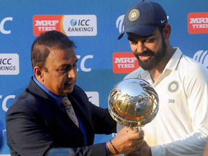 Former cricketer Sunil Gavaskar presenting the ICC Test Championship mace to Indian skipper Virat Kohli after the end of 3rd Test match against New Zealand in Indore.