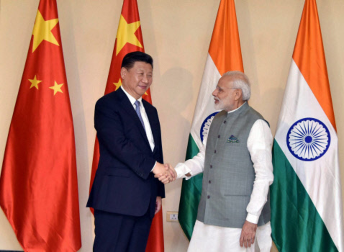 an analysis of the economic issues of china and india India is now clearly outperforming the other emerging nations, particularly china, a nation hobbled by a command economy and one of the most corrupt political systems on the planet.