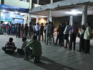 People stand in queue to withdraw money on November 8 after ATMs were declared closed on November 9.