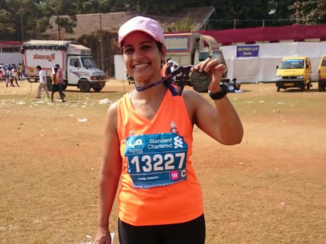 Tripathy is all smiles with her medal at the end of the marathon.