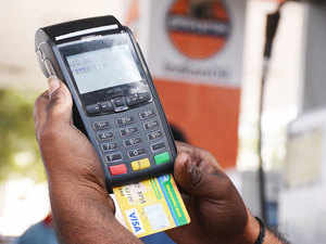 """In pic: Debit card being swiped.  The Economic Affairs Secretary Shaktikanta Das had earlier today said that: """"Public sector banks, some of the private banks and some of the service providers that provide switching services have agreed to waive the service charges on the use of debit cards up to December 31, 2016."""""""
