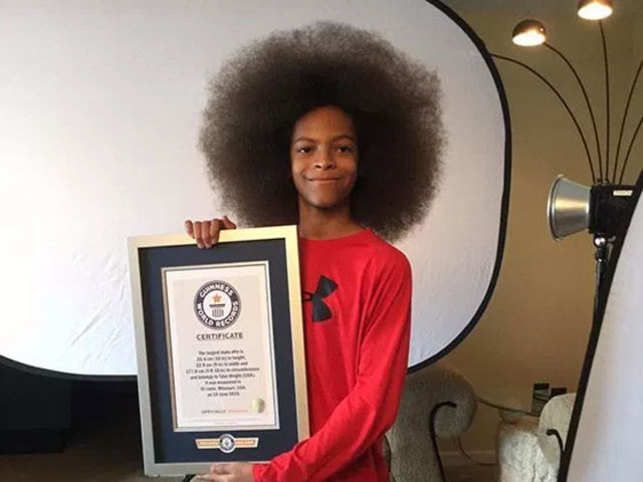 Afro means a head of hair. Previously the largest natural male Afro on record was 14.6 cm in height.