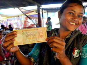 A tea vendor shows off Bhutanese currency. Indian currency used to be common in Bhutan until PM Narendra Modi demonetised Rs 500 and Rs 1,000 bank notes.