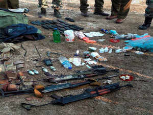 Army men showing arms and other items recovered from militants who attacked Nagrota camp, near Jammu on Wednesday.