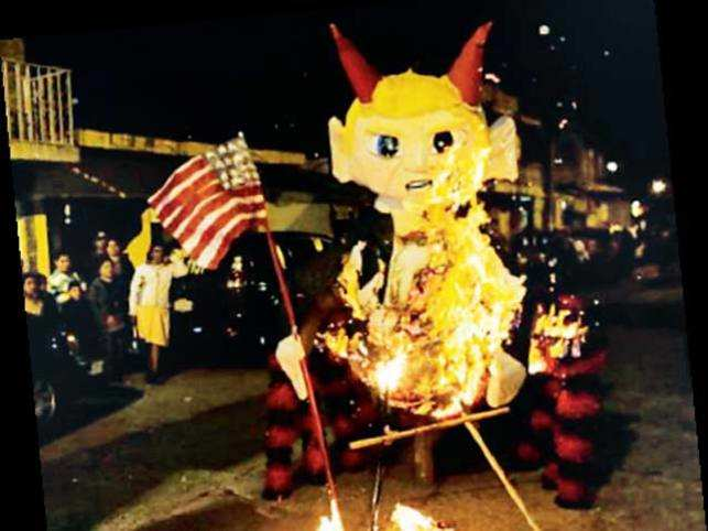 Guatemalans burn traditional devil puppets to start their Christmas celebrations.