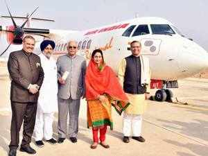 Union Civil Aviation Minister Ashok Gajapathi Raju with of Minister of State for Civil Aviation Jayant Sinha, Deputy Chief Minister Sukhbir Singh Badal and Union Minister for Food Processing Industries Harsimrat Kaur Badal poses with the first flight landed from Delhi at Bathinda Bathinda domestic airport, on Sunday.