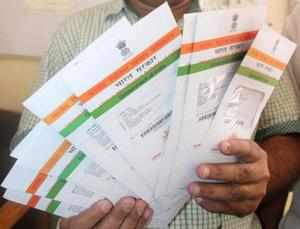 """If the transaction is done through the Aadhaar network, there's no need for extra charges,"""" said bankers aware of the discussions with the government."""