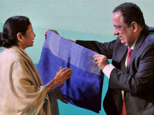West Chief Minister Mamata Banerjee being felicitated by Rajan B Raheja (R), Vice Chairman, Exide Industries Limited during the inauguration of 'State-of-the-Art Battery Making Plant' of Exide Industries Limited, at Haldia in East Midnapore district of West Bengal on Monday.