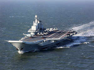 "The formation, which is on a ""cross-sea area"" training exercise, involved J-15 fighter jets, as well as several ship-borne helicopters, the official said without mentioning specific numbers."