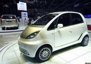 """The <b>Tata Nano EV</b> car is displayed on the exhibition stand of Tata during the first media day of the 80th Geneva Car Show at the Palexpo in Geneva on March 2, 2010. (Reuters)<hr><a href=""""/articleshowpics/4225199.cms"""" target=""""_blank""""><b>Nano Europa</b></a> 