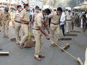 Cops with mops supporting the Swachch Bharat Mission.