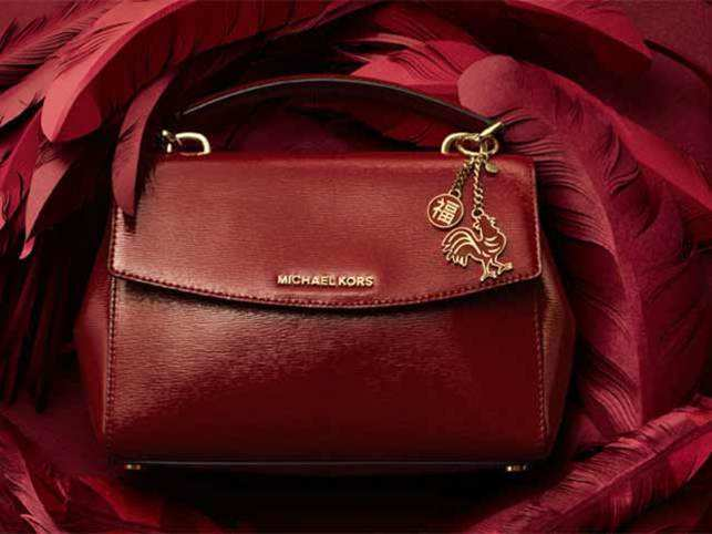 3bee5eac8fda Michael Kors Holdings Ltd., Prada SpA, LVMH's Louis Vuitton and Burberry  Group Plc