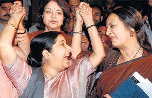 EUPHORIC: Brinda Karat & Sushma Swaraj celebrate. (PTI)