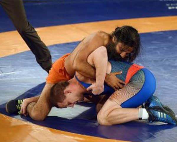 Watch: Baba Ramdev beats Olympic medalist in promotional wrestling bout