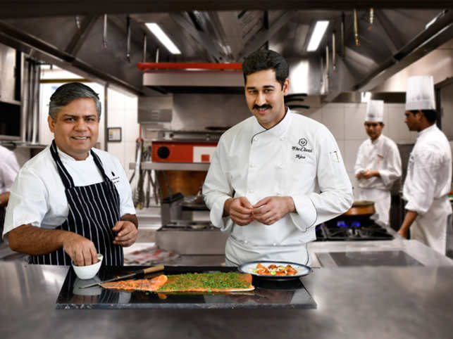 A Kitchen Symphony: Chef Vivek Singh (left), CEO of The Cinnamon Collection and Chef Tejas Sovani, Executive Sous Chef at Amaranta, The Oberoi Gurgaon.