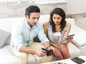 An online survey conducted by ET Wealth found that spending too much was the most common reason for money arguments among couples.