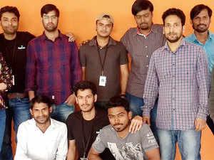 Cofounders Adarsh Kumar and Devashish Mamgain with the team.