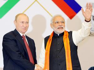 Russian President Vladimir Putin & Indian PM Narendra Modi in a file photo.