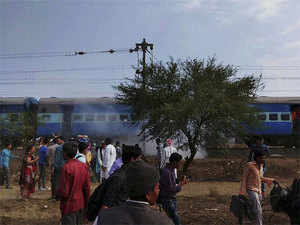Smoke emanates from a bogie after a blast in the Bhopal-Ujjain passenger train near Jabdi station in Shajapur district in Madhya Pradesh.