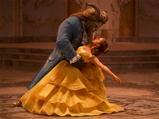 This image released by Disney shows Dan Stevens as The Beast, left, and Emma Watson as Belle.