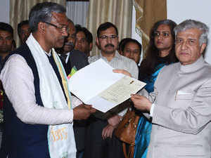 Rawat was appointed the party's national secretary in 2013  [In pic: Trivendra Singh Rawat and Uttarakhand Governor K K Paul]