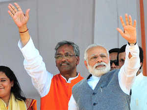With the new Chief Minister Trivendra Singh Rawat in tow, Modi left the venue waving to the crowds.
