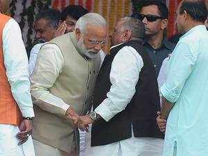 He also held the hands of Mulayam, who was seen whispering something to Modi.