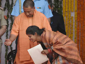 Swati Singh seeks blessings of Chief Minister Yogi Adityanath after taking oath as a State minister (independent charge) in Uttar Pradesh government.
