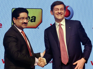 Aditya Birla Group chairman Kumar Mangalam Birla with Chief Executive Officer of Vodafone Group Vittorio Colao during the announcement of merger between Vodafone India and Idea Cellular in Mumbai