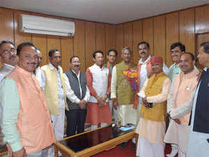 Newly elected MLAs welcome Chief Minister Trivendra Singh Rawat after the oath taking ceremony at the assembly, in Dehradun.